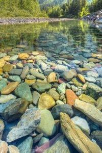 Pebble shore lake, glacier national park, montana
