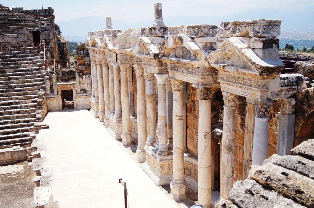 the ruins of the ancient hierapolis city next to the travertine pools of pamukkale turkey